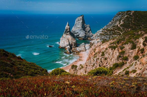 Surreal and bizarre Rocks at Praia Da Ursa Beach, Sintra, Portugal. Towering cliffs lit by evening - Stock Photo - Images