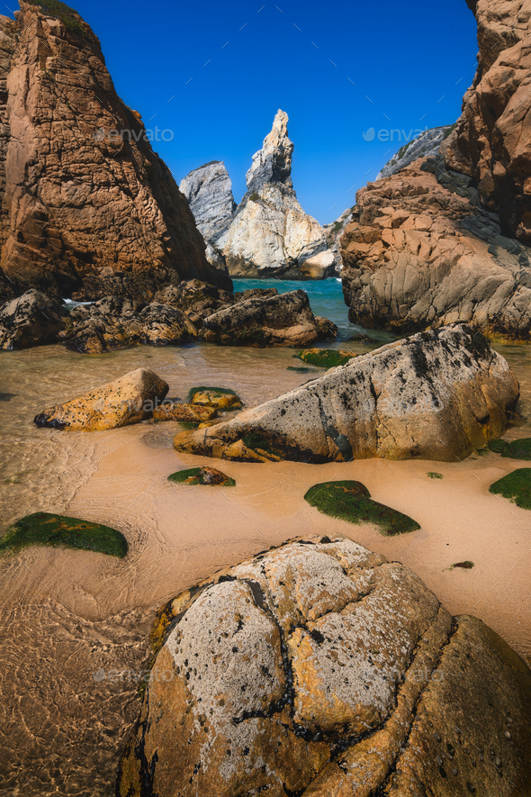 Ursa beach, Sintra, Portugal. Epic seascape with sharp cliffs rising from the turquoise sea waters - Stock Photo - Images