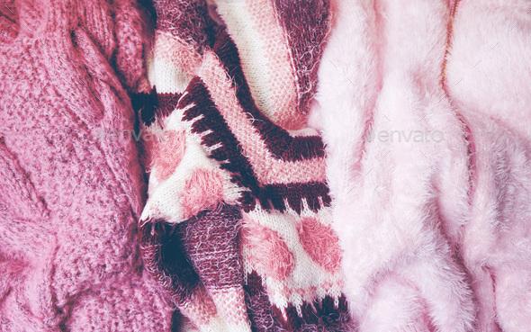 Beautiful woolen sweaters in pink tones - Stock Photo - Images