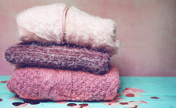 Beautiful woolen sweaters in pink tones - Stock Photo - Images
