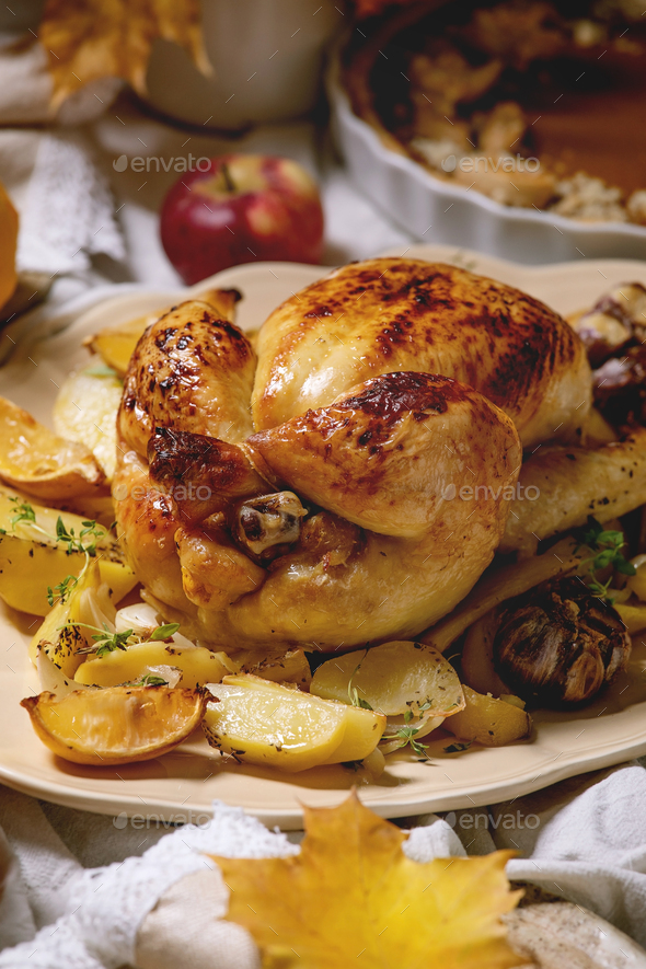 Baked chicken with potatoes - Stock Photo - Images
