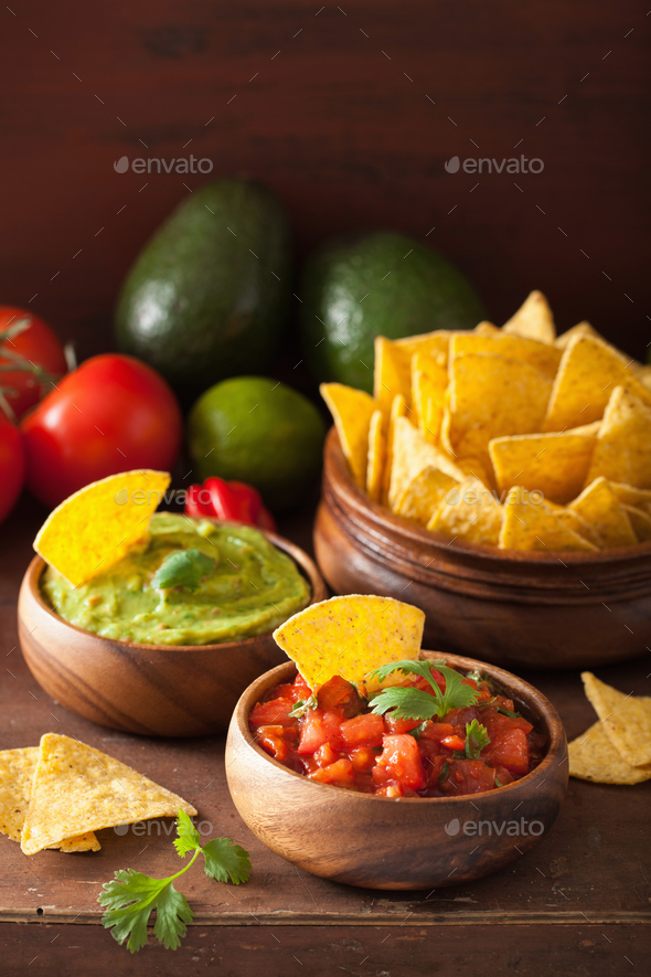 mexican nachos tortilla chips with guacamole and salsa dip - Stock Photo - Images