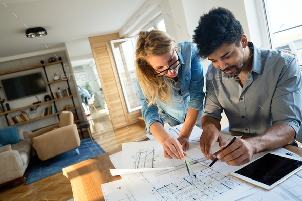 Businesspeople and architects planning - Stock Photo - Images