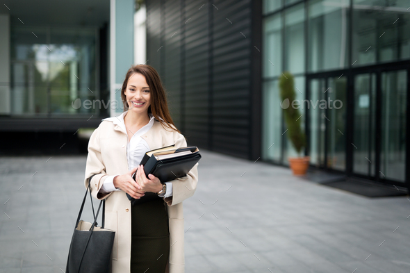 Attractive and beautiful business woman standing outdoor - Stock Photo - Images