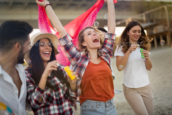 Group of happy young friends having great time on beach - Stock Photo - Images