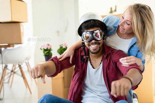 Happy young couple moving in new house - Stock Photo - Images