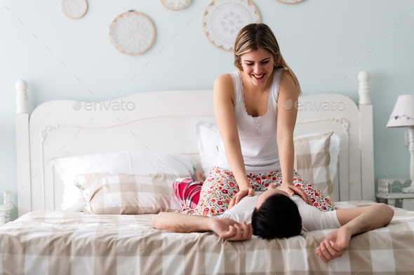 Young couple having romantic time in bedroom - Stock Photo - Images