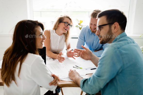 Picture of young architects discussing about project - Stock Photo - Images