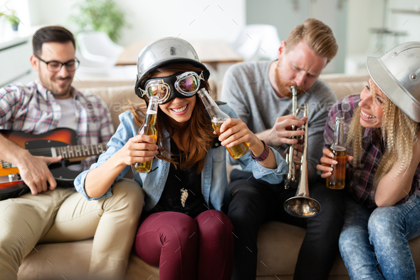 Group of happy friends having fun and party - Stock Photo - Images