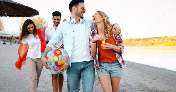 Group of young cheerful people bonding to each other and smiling - Stock Photo - Images