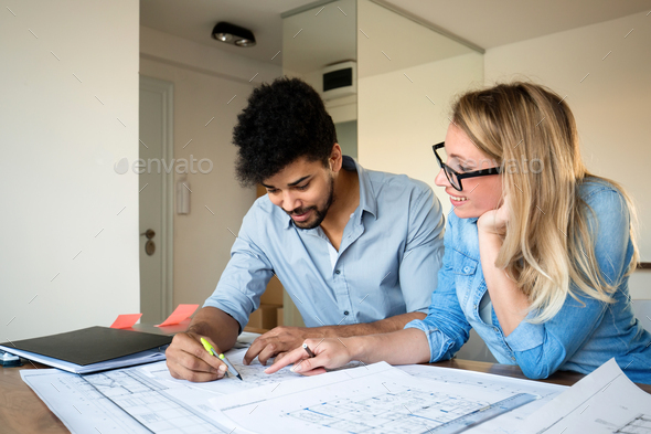 Office coworkers in business meeting discussing project plans - Stock Photo - Images