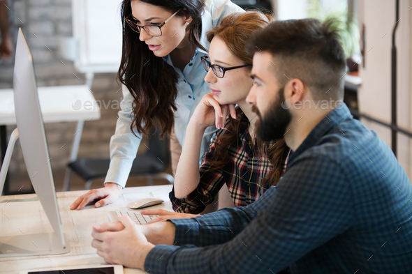 Group of young designers working as team - Stock Photo - Images