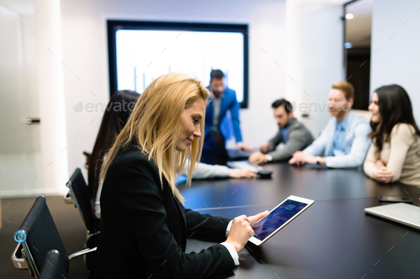 Portrait of beautiful businesswoman in conference room - Stock Photo - Images