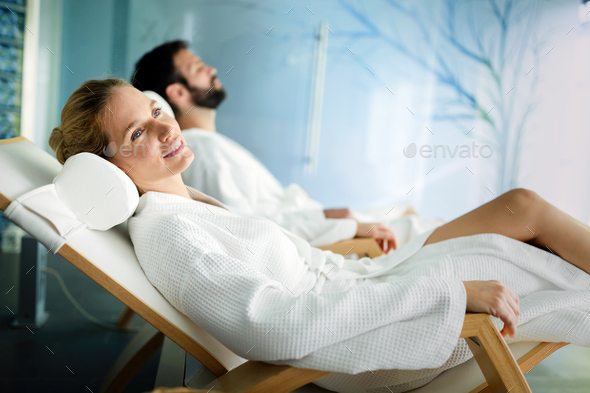 Handsome man and beautiful woman relaxing in spa - Stock Photo - Images