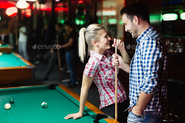 Happy couple drinking beer and playing snooker - Stock Photo - Images