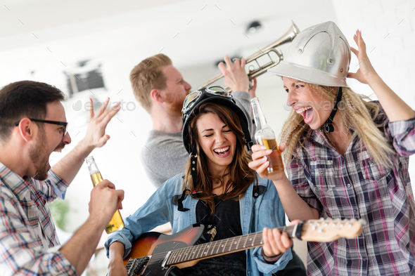 Cheerful friends having party and drinking beer - Stock Photo - Images