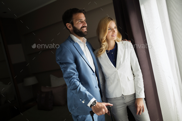 Picture of businessman and businesswoman in hotel room - Stock Photo - Images