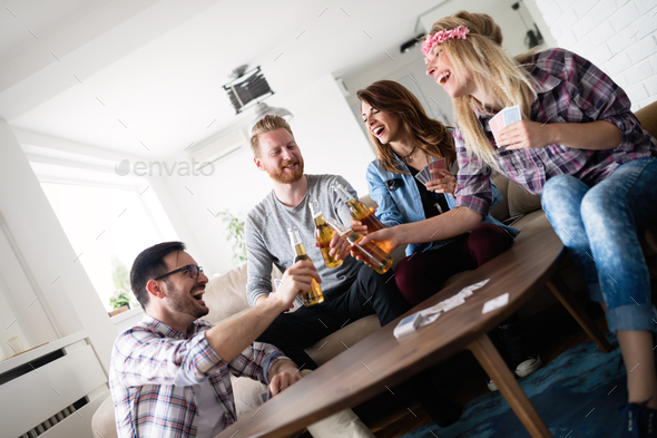 Young students and friends celebrating ahd having fun while drinking - Stock Photo - Images