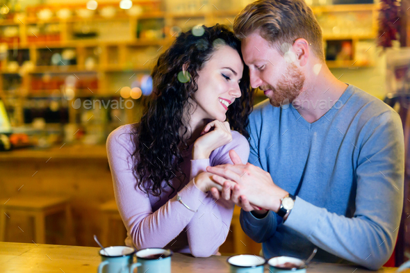 Romantic couple having date in coffee shop - Stock Photo - Images