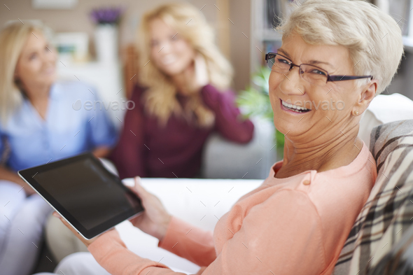 Even in my age you can use the new technology - Stock Photo - Images