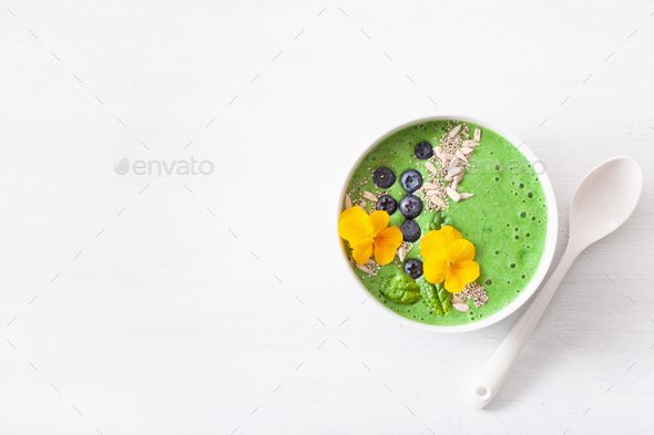 green spinach smoothie bowl with blueberry, chia seed and edible - Stock Photo - Images