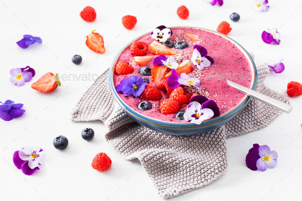 healthy summer berry smoothie bowl with flowers and chia seed - Stock Photo - Images