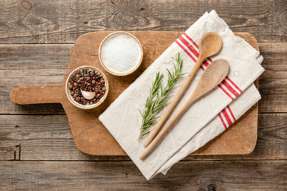 Cooking table with vintage cutting board, spoons and spices - Stock Photo - Images