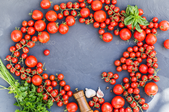 Fresh grape tomatoes with basil and garlic, pepper. - Stock Photo - Images