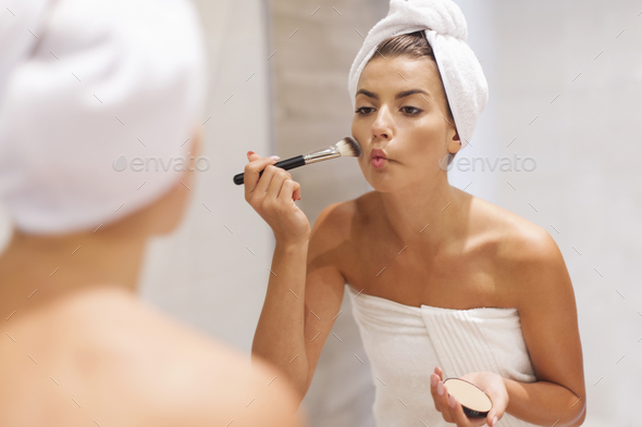 Adding some color to cheeks - Stock Photo - Images