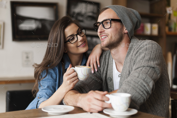 Happy man and woman in cafe - Stock Photo - Images