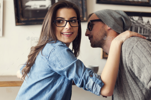Hipster couple flirting at cafe - Stock Photo - Images