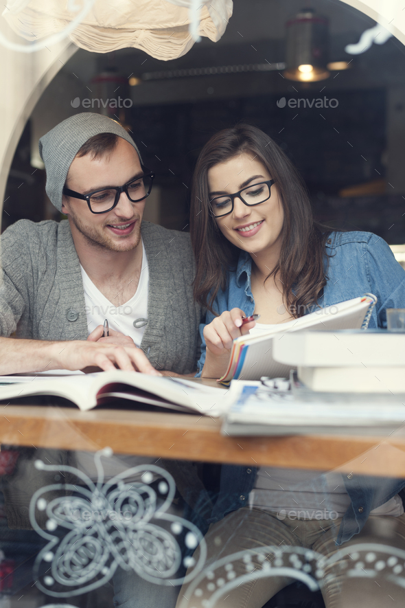 Hipster couple studying together at cafe - Stock Photo - Images