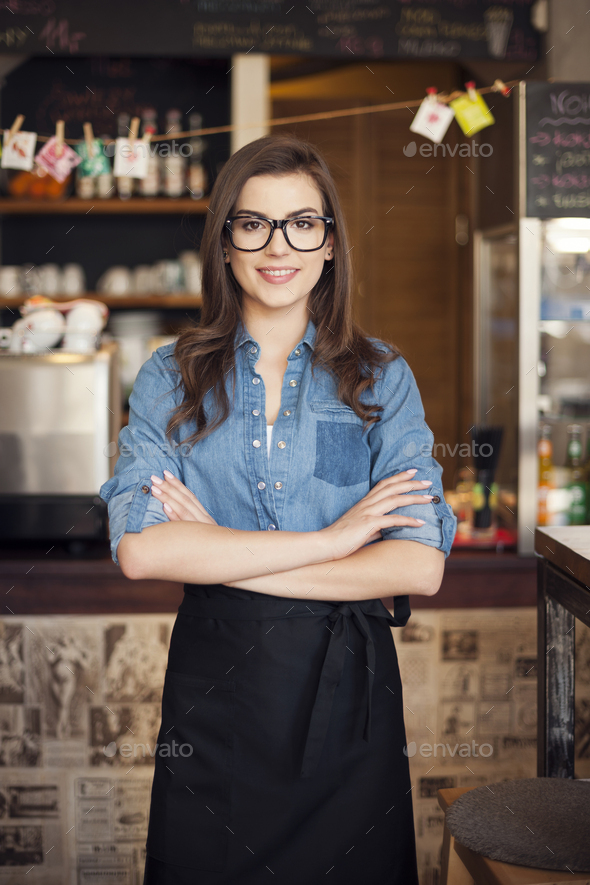 Portrait of nerdy waitress at work - Stock Photo - Images