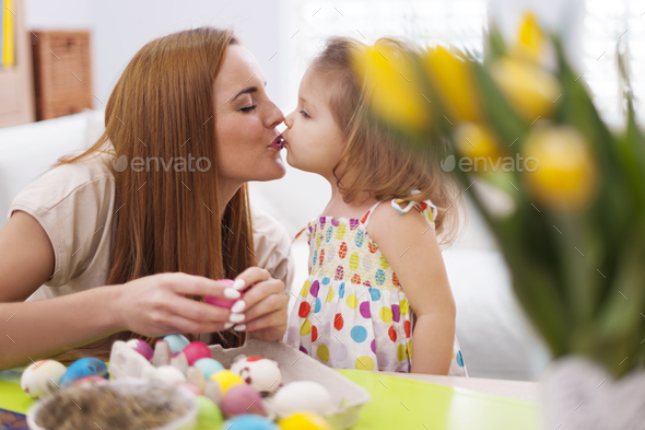 Loving mother and baby in easter time - Stock Photo - Images