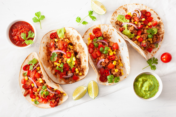 mexican beef and pork tacos with salsa, guacamole and vegetables - Stock Photo - Images