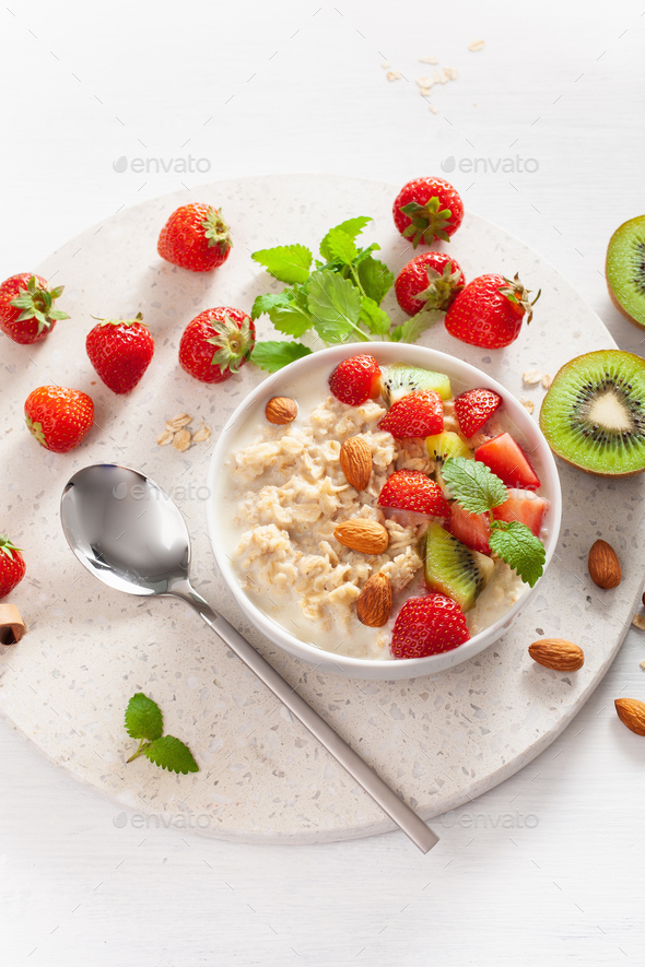 healthy breakfast oatmeal porridge, strawberry, nuts. Top view - Stock Photo - Images