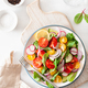 healthy colorful vegan tomato salad with cucumber, radish, onion - PhotoDune Item for Sale