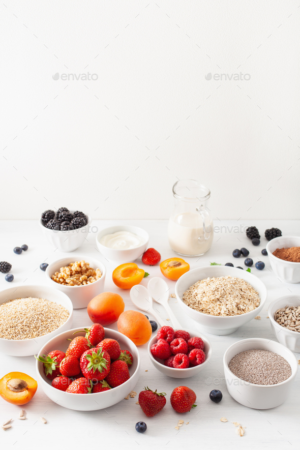 variaty of raw cereals, fruits and nuts for breakfast. Oatmeal f - Stock Photo - Images