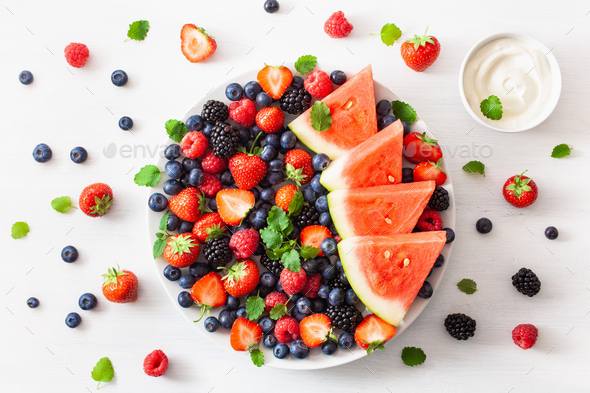 fruit and berry platter over white. blueberry, strawberry, raspb - Stock Photo - Images
