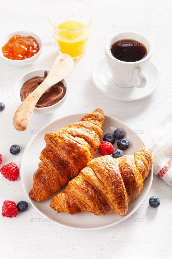 Continental breakfast with croissant, jam, chocolate spread and - Stock Photo - Images