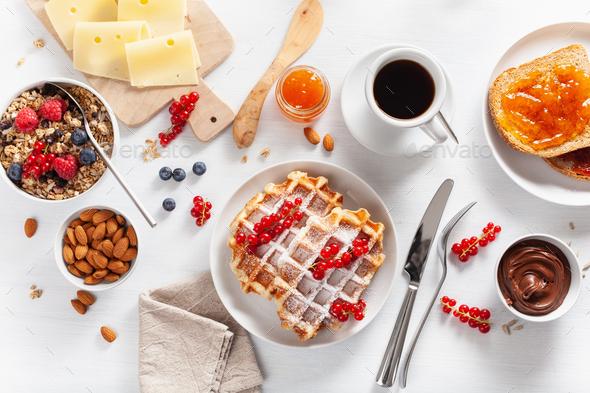 breakfast granola berry nuts, waffle, toast, jam, chocolate spre - Stock Photo - Images
