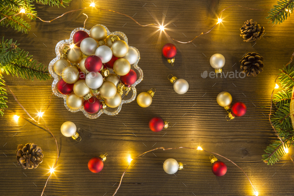 Refined Christmas composition seen from above with Christmas balls in a glass cake stand - Stock Photo - Images