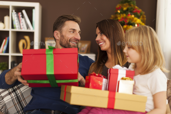 Happy family in christmas time at home - Stock Photo - Images