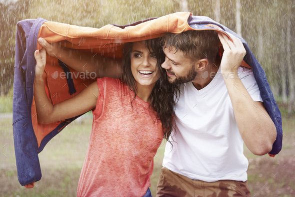 Oh baby, I have to protect you from the rain - Stock Photo - Images