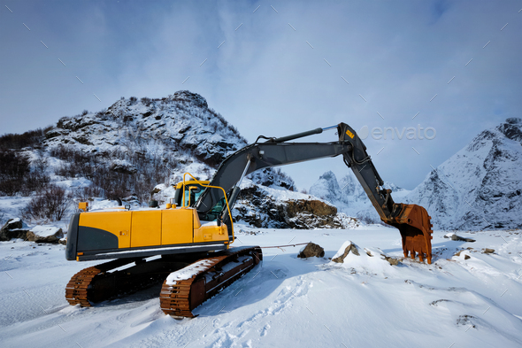 Old excavator in winter - Stock Photo - Images