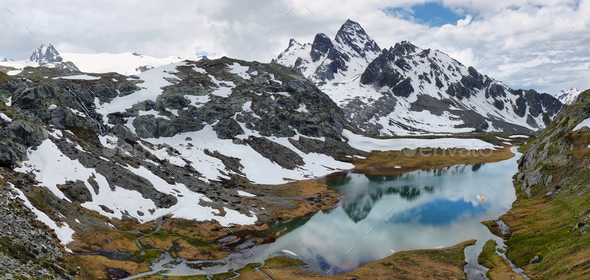 Amazing turquoise Lake on the way to Rutor Glacier, Aosta Valley, Italy - Stock Photo - Images