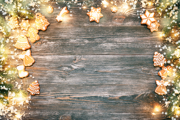 Christmas Frame with Gingerbread, Fir Branches and Garland. - Stock Photo - Images