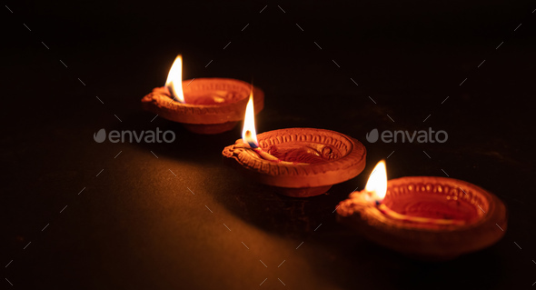 Happy Diwali. Diya colorful oil lamps, dark background - Stock Photo - Images