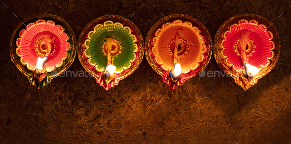Happy Diwali. Diya colorful oil lamps top view, - Stock Photo - Images
