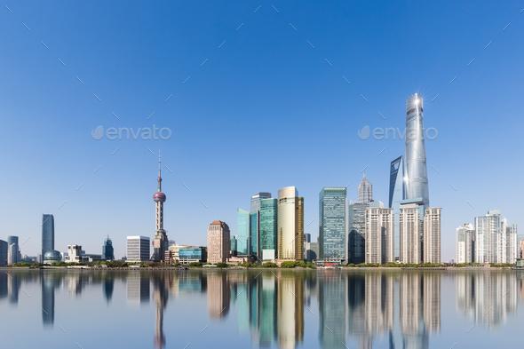shanghai skyline and reflection against a sunny sky - Stock Photo - Images
